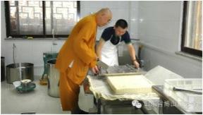 Ven. Ren Da works with temple tofu making